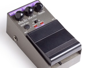 an analog delay effects pedal isolated on a white background
