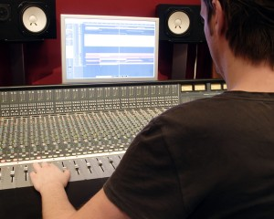 audio mixing panel with operator in action